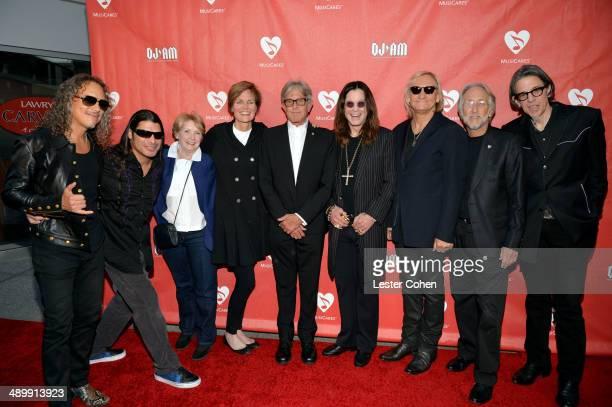Musicians Kirk Hammett and Robert Trujillo of Metallica MusiCares Vice President of Events Dana Tomarken GRAMMY Foundation Senior Vice President...