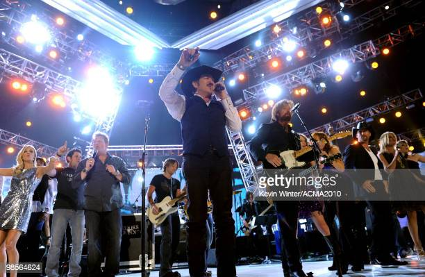 Musicians Kix Brooks and Ronnie Dunn of the band Brooks Dunn perform onstage with musicians Carrie Underwood Jay DeMarcus Gary LeVox Keith Urban...
