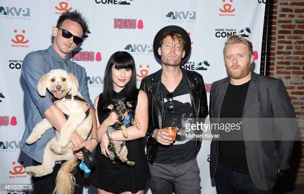 Musicians Kris Kovacs Ellie Innocenti Robbie G and Stevie J Palmer of musical group 'Deluka' enjoy the 'More Than a Cone' art auction and campaign...