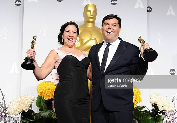 Musicians Kristen AndersonLopez and Robert Lopez pose in the press room at the 86th annual Academy Awards at Dolby Theatre on March 2 2014 in...