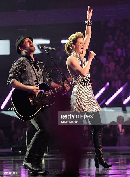Musicians Kristian Bush and Jennifer Nettles of Sugarland perform on stage at the 2009 CMT Music Awards at the Sommet Center on June 16, 2009 in...