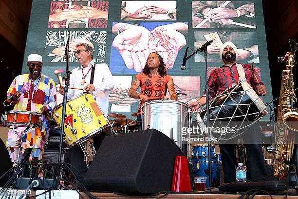 Musicians Kwame Steve Cobb Rich Conti Carlos Cornier and Maninderpal Singh of Funkadesi performs at the Jay Pritzker Pavilion in Millennium Park in...