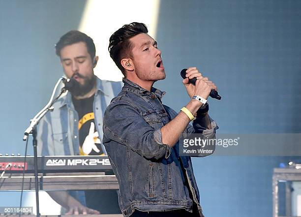 Musicians Kyle J Simmons and Dan Smith of Bastille perform onstage during 1067 KROQ Almost Acoustic Christmas 2015 at The Forum on December 12 2015...