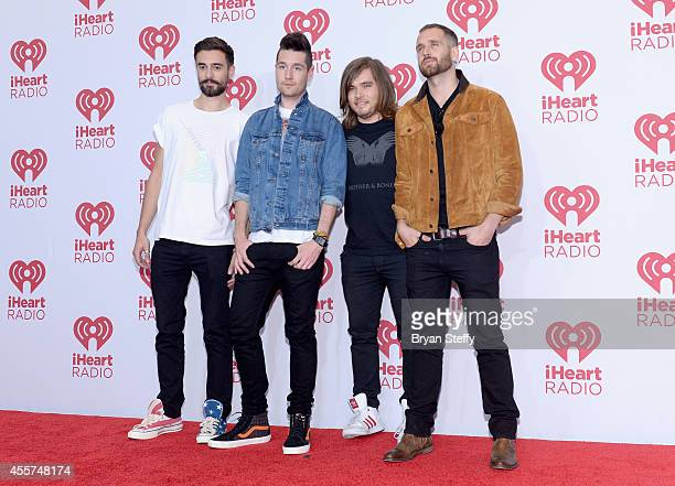 Musicians Kyle Simmons Dan Smith Chris Wood and William Farquarson of Bastille attend the 2014 iHeartRadio Music Festival at the MGM Grand Garden...