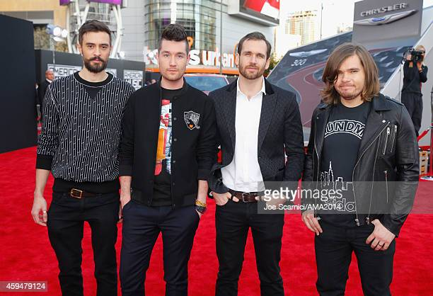 Musicians Kyle Simmons Dan Smith Will Farquarson and Chris 'Woody' Wood of Bastille attend the 2014 American Music Awards red carpet arrivals...