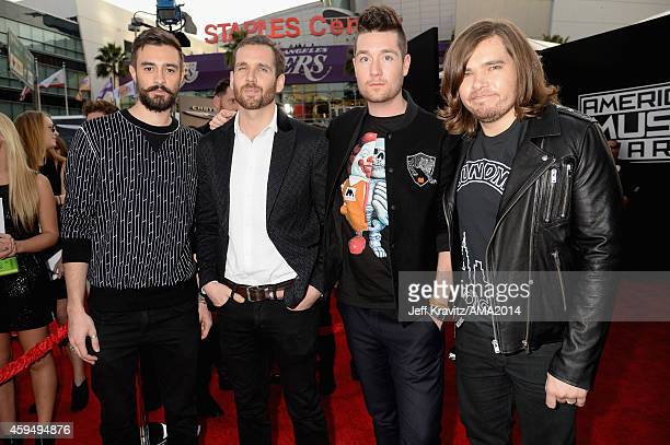 Musicians Kyle Simmons William Farquarson Dan Smith and Chris 'Woody' Wood of Bastille attend the 2014 American Music Awards at Nokia Theatre LA Live...