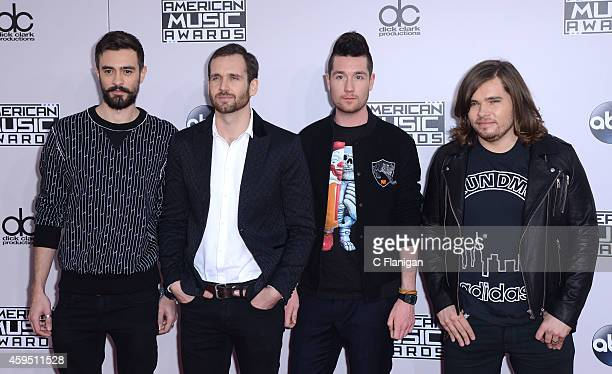 Musicians Kyle Simmons William Farquarson Dan Smith and Chris 'Woody' Wood of Bastille attend the 42nd Annual American Music Awards at Nokia Theatre...