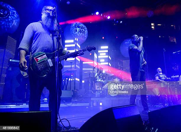 Musicians Kyp Malone Jahphet Landis Tunde Adebimpe and Dave Sitek of TV On The Radio perform onstage during the Annenberg Foundation and KCRW's...