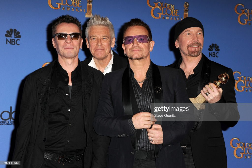 Musicians Larry Mullen Jr., Adam Clayton, Bono, and The Edge of U2 pose in the press room during the 71st Annual Golden Globe Awards held at The Beverly Hilton Hotel on January 12, 2014 in Beverly Hills, California.