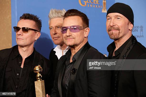 Musicians Larry Mullen Jr Adam Clayton Bono and The Edge of U2 pose in the press room during the 71st Annual Golden Globe Awards held at The Beverly...