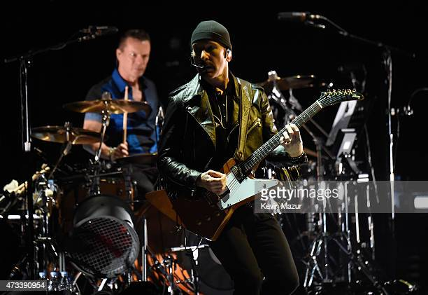 Musicians Larry Mullen Jr and The Edge of U2 perform onstage during the U2 iNNOCENCE eXPERIENCE tour opener in Vancouver at Rogers Arena on May 14...
