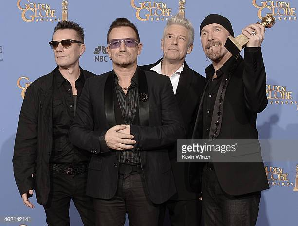 Musicians Larry Mullen Jr Bono Adam Clayton and The Edge of U2 winners of Best Original Song for 'Ordinary Love' from 'Mandela Long Walk to Freedom'...
