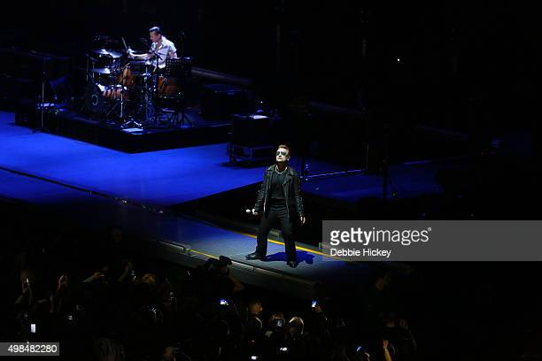 Musicians Larry Mullen Jr Bono and Adam Clayton of U2 perform onstage at 3 Arena on November 23 2015 in Dublin Ireland