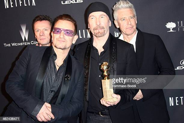 Musicians Larry Mullen Jr Bono The Edge and Adam Clayton of music group U2 attends the Weinstein Company's 2014 Golden Globe Awards after party on...
