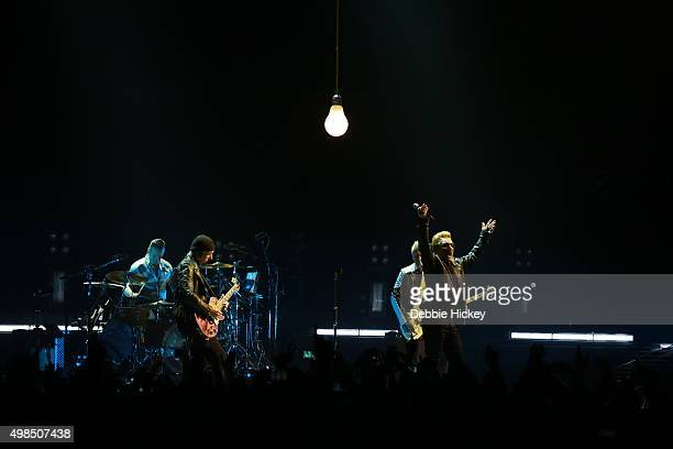 Musicians Larry Mullen Jr The Edge Adam Clayton and Bono of U2 perform onstage at 3 Arena on November 23 2015 in Dublin Ireland