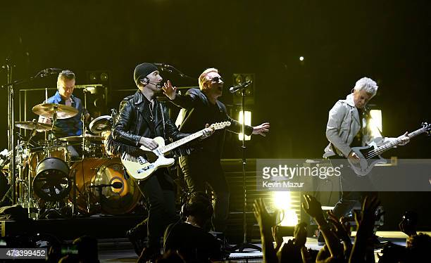 Musicians Larry Mullen Jr The Edge Bono and Adam Clayton of U2 perform onstage during the U2 iNNOCENCE eXPERIENCE tour opener in Vancouver at Rogers...
