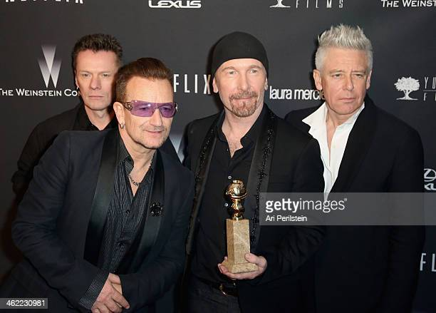 Musicians Larry Mullen JrBono The Edge and Adam Clayton of U2 attend The Weinstein Company Netflix's 2014 Golden Globes After Party presented by...