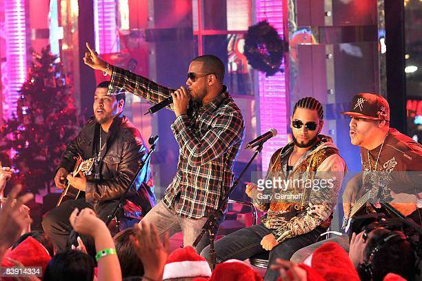 Musicians Lenny Santos Anthony Santos Henry Santos Jeter and Max Santos of the bachata pop band Aventura perform live on stage at MTV's Mi TRL at MTV...