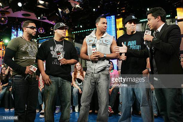 Musicians Lenny Santos Henry Santos Anthony Santos and Max Santos of Aventura appear onstage with host Carlos Santos during MTV's Mi TRL at the MTV...