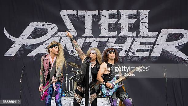 Musicians Lexxi Foxx Michael Starr and Satchel of Steel Panther perform at MAPFRE Stadium on May 21 2016 in Columbus Ohio