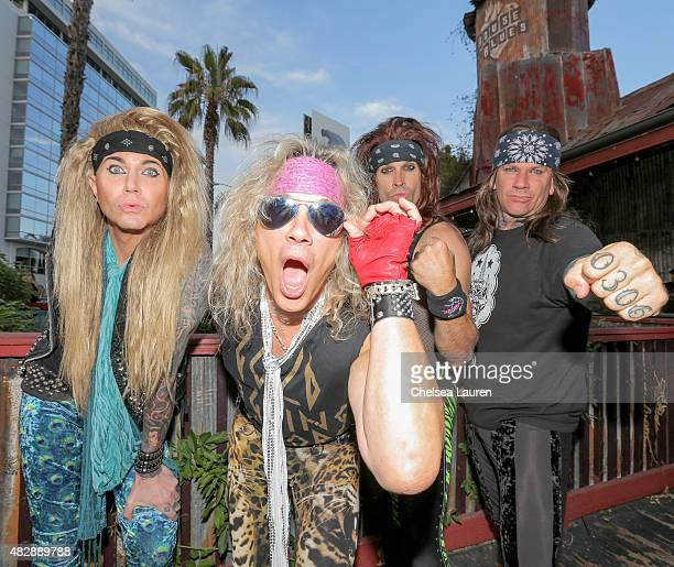Musicians Lexxi Foxxx Michael Starr Satchel and Stix Zadinia of Steel Panther pose before their farewell concert at House of Blues Sunset Strip on...