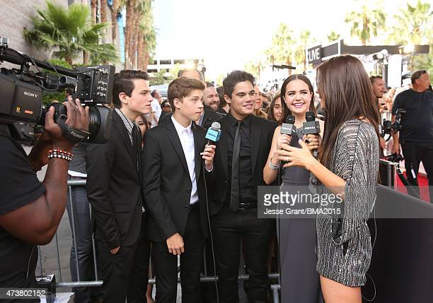 Musicians Liam Attridge Ricky Garcia and Emery Kelly of Forever in Your Mind with actresses Bailee Madison and Chelsea Cannell attend the 2015...