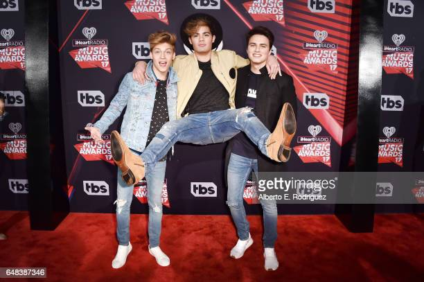 Musicians Liam Attridge Ricky Garcia and Emery Kelly of music group Forever in Your Mind attend the 2017 iHeartRadio Music Awards which broadcast...
