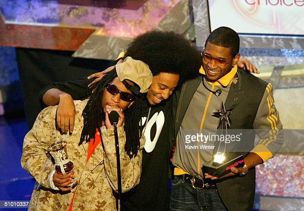 Musicians Lil Jon Ludacris and Usher accept the Viewer's Choice Award on stage at the 2004 Black Entertainment Awards held at the Kodak Theatre on...