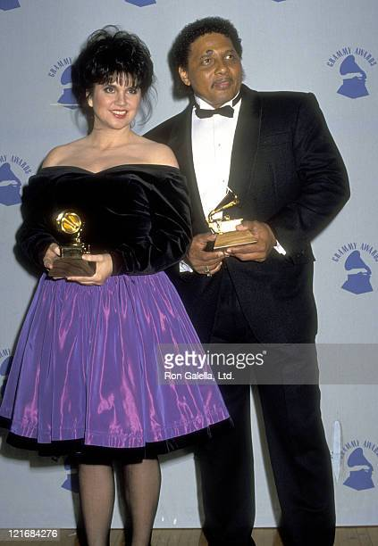 Musicians Linda Ronstadt and Aaron Neville attend the 32nd Annual Grammy Awards on February 21 1990 at Shrine Auditorium in Los Angeles California