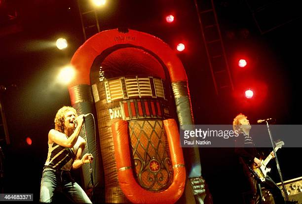 Musicians Lou Gramm and Rick Wills of the group Foreigner perform onstage at an unspecified venue Chicago Illinois November 8 1981