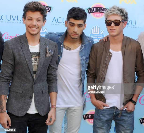 Musicians Louis Tomlinson Zayn Malik and Niall Horan of One Direction arrive at the 2013 Teen Choice Awards at Gibson Amphitheatre on August 11 2013...