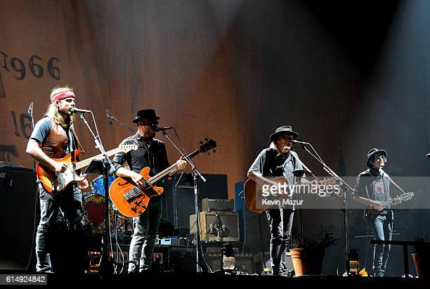 Musicians Lukas Nelson Corey McCormick Neil Young and Jacob Micah Nelson of Neil Young Promise of the Real perform onstage during Desert Trip at The...