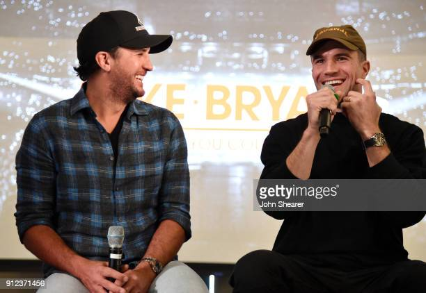 Musicians Luke Bryan left and Sam Hunt appear on stage at the announcement for the What Makes You Country tour at WME Nashville on January 30 2018 in...