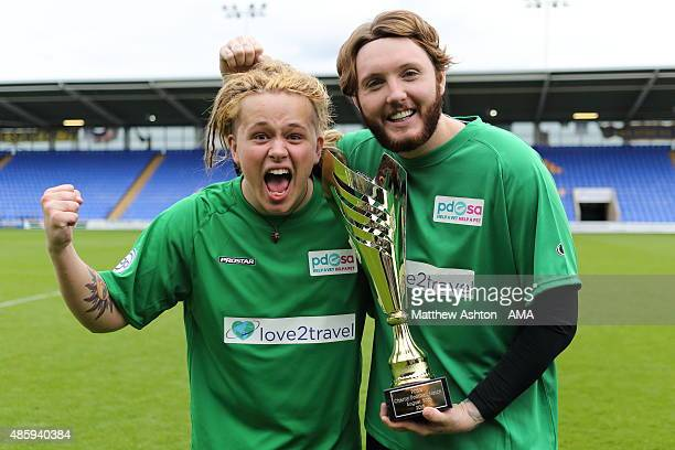 Musicians Luke Friend and James Arthur celebrate with the trophy after a charity football match in aid of PDSA at Greenhous Meadow home of Shrewsbury...