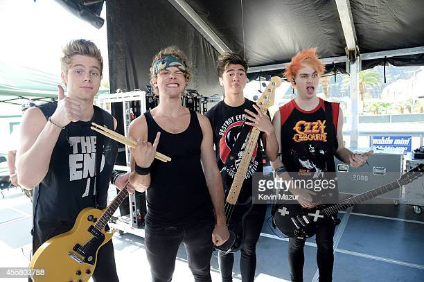 Musicians Luke Hemmings Ashton Irwin Calum Hood and Michael Clifford of 5 Seconds of Summer pose onstage during the 2014 iHeartRadio Music Festival...