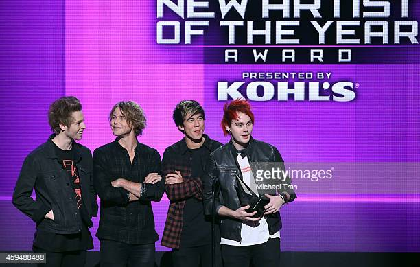Musicians Luke Hemmings, Ashton Irwin, Calum Hood and Michael Clifford of 5 Seconds of Summer accept the award for New Artist of the Year Presented...
