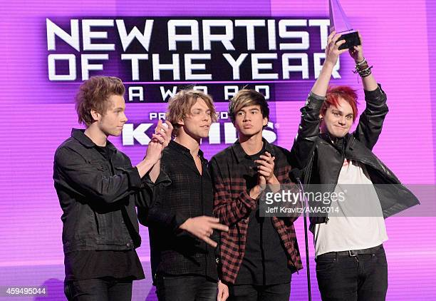 Musicians Luke Hemmings Ashton Irwin Calum Hood and Michael Clifford of 5 Seconds of Summer speak onstage at the 2014 American Music Awards at Nokia...
