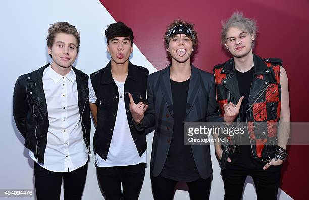 Musicians Luke Hemmings Calum Hood Ashton Irwin and Michael Clifford of 5 Seconds of Summer attend the 2014 MTV Video Music Awards at The Forum on...