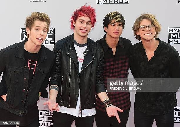 Musicians Luke Hemmings, Michael Clifford, Calum Hood and Ashton Irwin of 5 Seconds of Summer attend the 2014 American Music Awards at Nokia Theatre...
