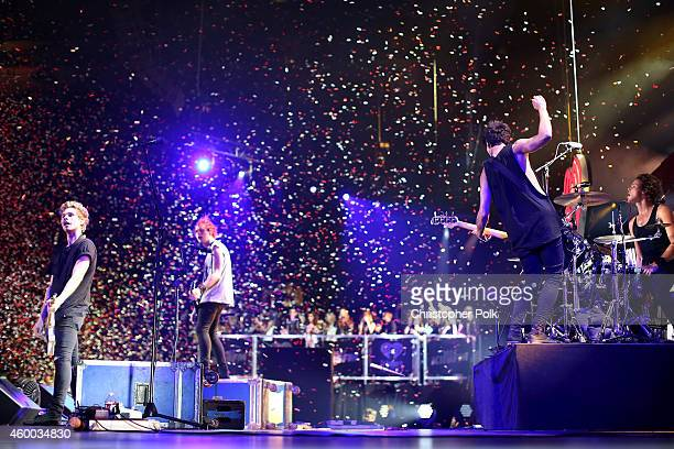 Musicians Luke Hemmings Michael Clifford Calum Hood and Ashton Irwin of 5 Seconds of Summer perform onstage during KIIS FM's Jingle Ball 2014 powered...