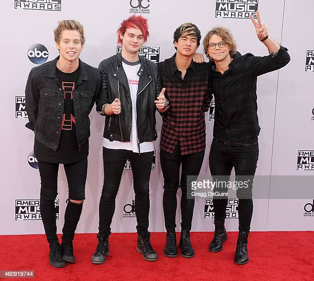 Musicians Luke Hemmings Michael Clifford Calum Hood and Ashton Irwin of 5 Seconds of Summer arrive at the 2014 American Music Awards at Nokia Theatre...