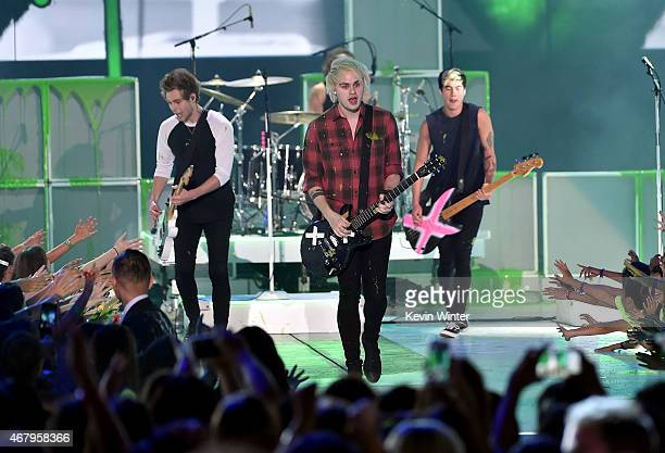 Musicians Luke Hemmings Michael Clifford Calum Hood and Ashton Irwin of 5 Seconds of Summer perform onstage during Nickelodeon's 28th Annual Kids'...