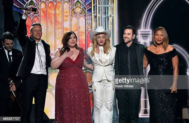 Musicians Macklemore Mary Lambert Madonna Ryan Lewis and Queen Latifah perform onstage during the 56th GRAMMY Awards at Staples Center on January 26...