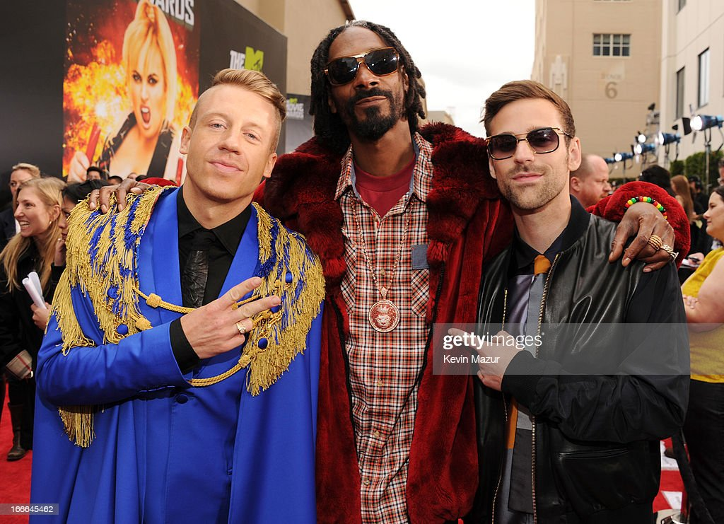 Musicians Macklemore, Snoop Dogg and Ryan Lewis arrive at the 2013 MTV Movie Awards at Sony Pictures Studios on April 14, 2013 in Culver City, California.