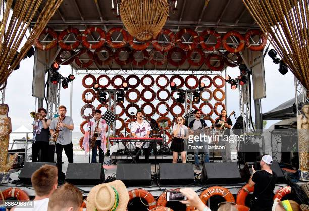 Musicians Marc Langer Sumner Becker Jordan Cohen Clyde Lawrence Sam Askin Gracie Lawrence Jonny Koh and Michael Karsh of Lawrence perform at the BMI...