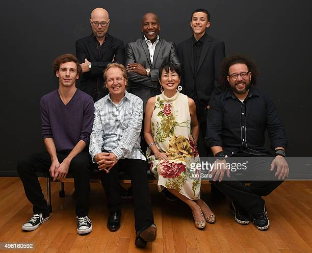 Musicians Marcus Cesar Hiroko Kokubu Lee Ritenour Wesley Ritenour Noah East Nathan East and John Beasley pose for a photograph backstage during...