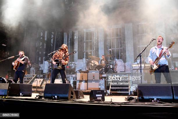 Musicians Marcus Mumford Winston Marshall and Ted Dwane of the band Mumford Sons perform at the Hangout Stage during 2017 Hangout Music Festival on...