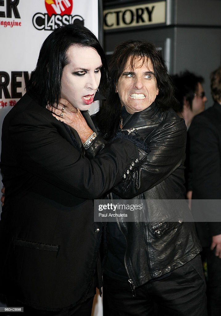 Musicians Marilyn Manson (L) and Alice Cooper arrive at the 2nd annual Revolver Golden Gods Awards at Club Nokia on April 8, 2010 in Los Angeles, California.