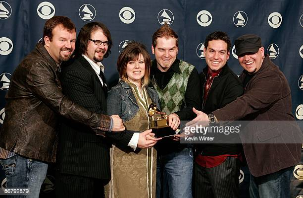 Musicians Mark Hall Juan Devevo Melodee Devevo Chris Hoffman Hector Cervantes and Andy Williams of the group Casting Crowns pose with their award for...