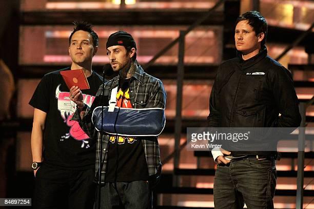 Musicians Mark Hoppus Travis Barker and Tom DeLonge of Blink 182 speak during the 51st Annual Grammy Awards held at the Staples Center on February 8...